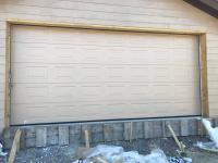 Гаражные подъёмно-секционные ворота Alutech Trend в Ладога Ленде